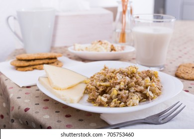 porridge from flakes of different varieties of grain, cheese and milk for healthy breakfast