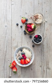 Porridge with fresh fruit on a wooden table