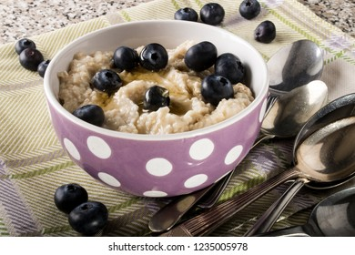 porridge made with sweet honey and blueberries in a bowl