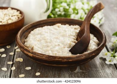 Porridge with milk in the ceramic plate
