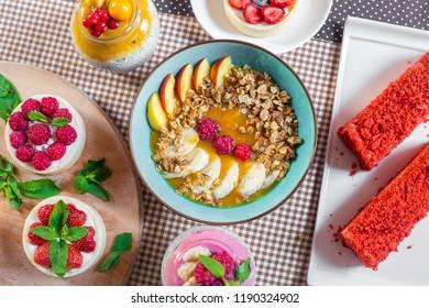 Porridge of muesli with fruit. Fresh fruit in porridge. Muesli with fruits. Muesli with fruit puree.