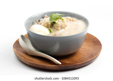 porridge rice in ceramic bowl on white background