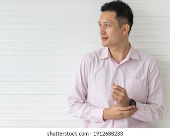 Porrtrait of yound smile face Asian man in casual shirt.