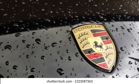 Porsche logo on black car with rain drop. Bangkok, Thailand. - Oct 20, 2018.