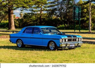 Port Adelaide, South Australia - October 14, 2017: Iconic Australian made Ford Falcon 351-GT parked on the grass on a day
