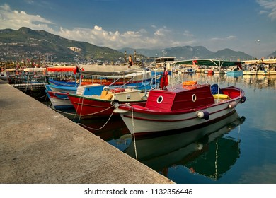 Port in Alanya, Turkey, in the foreground small fishing boats