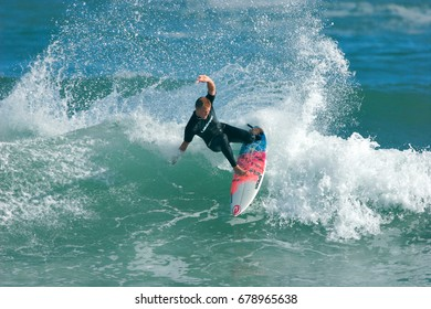PORT ALFRED, SOUTH AFRICA - 3 JULY 2012: A surfer executes a radical move on an ocean wave. The sport of surfing represents a multibillion-dollar industry especially in the fashion markets. Editorial.