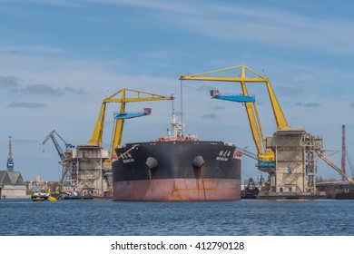 Port of Amsterdam, Noord-Holland/Netherlands - April 22-04-16 - Huge Bulk Carrier MEI HUA HAI is being discharged by floating cranes in the port of Amsterdam. Nice maritime industrial picture.