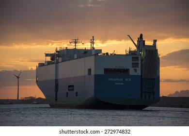Port of Amsterdam, Noord-Holland/Netherlands - April 25-04-2015 - Big RO-RO ship Aquarius Ace is finished with cargo operations and is sailing to sea. Photo taken during sunset.