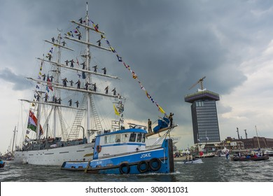 Port of Amsterdam, Noord-Holland/Netherlands - August 19-08-2015 - Tugboat Joke is assisting with towing of the tallship Tarangini (India). Photo taken during the big nautical event SAIL 2015.