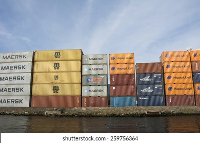 Port of Amsterdam, Noord-Holland/Netherlands - March 09-03-15 - Containers from MSC, Maersk, Hapag-Lloyd, NYK Logistics, P&O Nedlloyd. placed at the shore. With bright sky at the background.