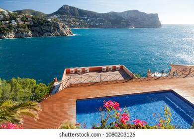 PORT ANDRATX,SPAIN-JANUARY 12,2016:Mediterranean sea coast and pool of residence building in Port Andratx, Mallorca island, Balearic islands.