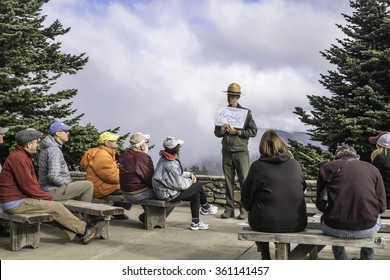 PORT ANGELES, WASHINGTON/USA - SEPTEMBER 22, 2015: A park ranger displays a temperature graph as he discusses climate change with visitors at Hurricane Ridge Visitor Center in Olympic National Park.