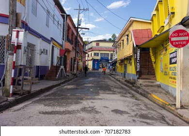 PORT ANTONIO, JAMAICA - JANUARY 1, 2014: Unidentified people walking on the colorful streets of downtown Port Antonio, Jamaica on New Years Day morning 2014.
