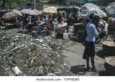 Port Au Prince, Haiti - Circa August 2015: Piles of rubbish in the middle of food stalls in a busy market in Port Au Prince