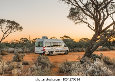Port Augusta, AUSTRALIA - Oct 01, 2017: Australian rented motorhome stopped in at bush campgroung in Flinders Ranges region near Port Augusta at sunset.