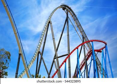 PORT AVENTURA, SPAIN - MAY, 11. Attractions Shambhala and Dragon Khan in the theme park Port Aventura on May 11, 2015 in city Salou, Catalonia, Spain.