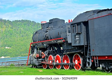 PORT BAIKAL - AUGUST 24 - Old steam locomotive standing by the Lake Baikal at Baykal station on the Circum-Baikal Railway (ex Trans-Siberian Railway) seen on August 24, 2016 in Port Baikal, Russia