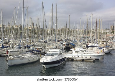 port in barcelona with a lot boat and yacht.