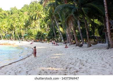 Port Barton, Palawan / Philippines - February 4 2019 - Foreign tourists in the White Beach near Port Barton