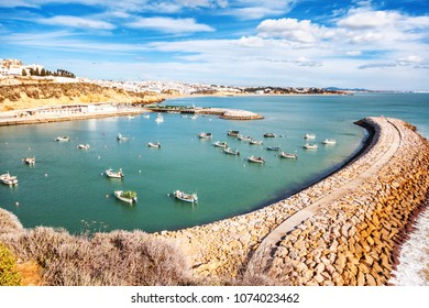port with boats and yachts in Albufeira, a city on the Atlantic coast in Portugal. Beautiful sea city landscape
