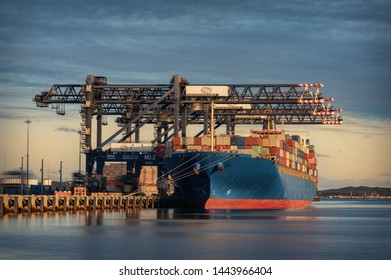 Port Botany, Sydney NSW Australia 6 July 2019 Chinese designed and constructed container loading cranes at work unloading cargo ship.