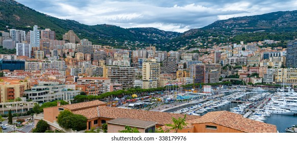 Port and buildings of the Bay of Monaco. View. Principality of Monaco in August 2015, Building concentration, the concentration of wealth. Basically the chain of the Alps.