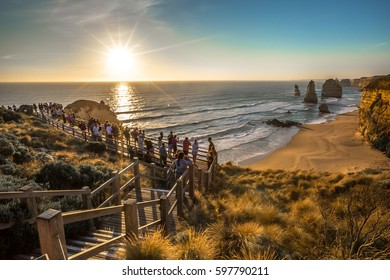 Port Campbell National Park, Victoria, Australia - January 6, 2015: Tourists observe the Twelve Apostles at sunset from the viewing platform in Port Campbell NP on Great Ocean Road