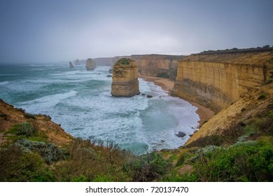 Port Campbell National Park, Victoria, Australia - August 2017. View of 12 Apostles in a cloudy and rainy winter morning