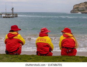Port Campbell, Victoria, Australia- December 23 2017: Life guards on surf rescue duty watch closely the Port Campbell Bay during bad weather.