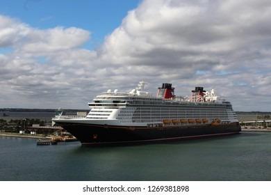 Port Canaveral FL/USA: December 10, 2018 –  Disney Dream cruise ship docked at Port Canaveral Florida on cloudy day
