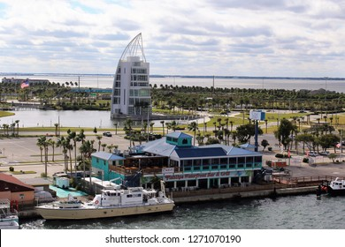 Port Canaveral FL/USA: December 10, 2018 –View of Exploration Tower and Fishlips Bar and Grill at water's edge in Port Canaveral on a cloudy late afternoon. Open water is visible in distance.