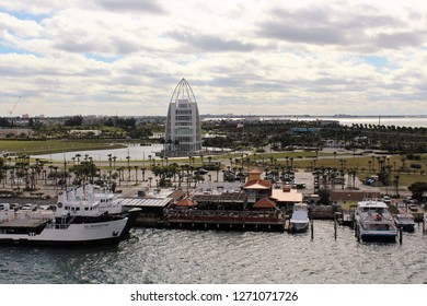 Port Canaveral FL/USA: December 10, 2018 – View of Exploration Tower and watercraft in Port Canaveral, plus parking area for port visitors on a cloudy late afternoon.