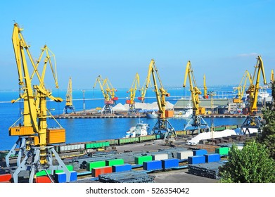 Port cargo crane and railroad over blue sky background