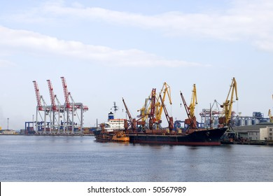 port with cargo cranes and vessel