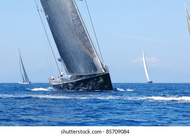 PORT CERVO, ITALY-SEPT. 10: Unidentified team participates at the Maxi Yacht Rolex Cup boat race on September 10, 2011 in Porto Cervo, Italy