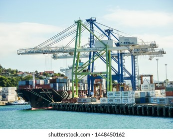 "Port Chalmers, New Zealand - January 14 2011: Container ship ""Maersk Danville"" load & discharges under two gantry cranes"