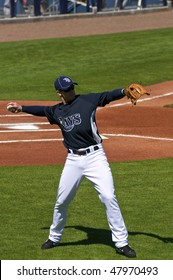 PORT CHARLOTTE, FLORIDA - MARCH 4: Evan Longoria of the Tampa Bay Rays warms up prior to a game against the Baltimore Orioles on March 4, 2010 in Port Charlotte, Florida