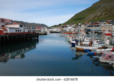 Its a port and cityscape of Honningsvag, one of the northernmost city in Norway and  in the world,  fishers and indusctrial vessels are at biggest port of Mageroya Island,