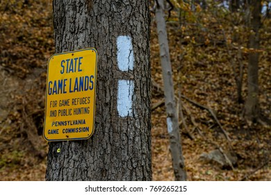 Port Clinton, PA, USA - December 3, 2017: A State Game Lands sign at Hash Marks for theAppalachian Trail near the Schuylkill River.