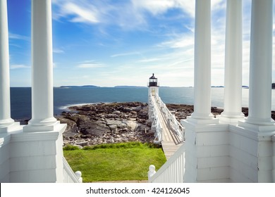 PORT CLYDE, ME - MAY 14: Viewing the Marshall Point Light and boardwalk from the porch of the light keeper's house on May 14, 2016 in Port Clyde, Maine.