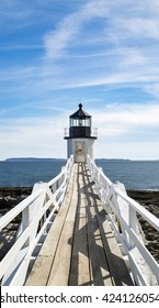 PORT CLYDE, ME - MAY 14: Looking down the boardwalk at Marshall Point Light on May 14, 2016 in Port Clyde, Maine.