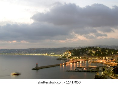 the port and coastline of the city of nice at dusk