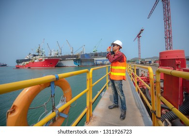 port controller, harbor master in command on the terminal port for safety and control security during the operation of ship in port