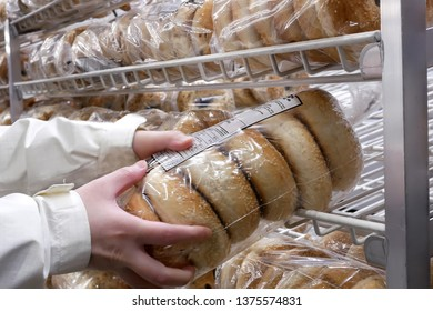 Port Coquitlam, BC, Canada - February 20, 2019 : Close up of people buying bagel inside Costco store