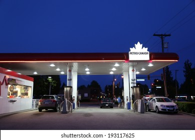 Port Coquitlam BC Canada - May 10, 2014 : One side of Petro Canada gas station on May 10, 2014. The company retained the Suncor Energy name for the merged corporation and its upstream operations.