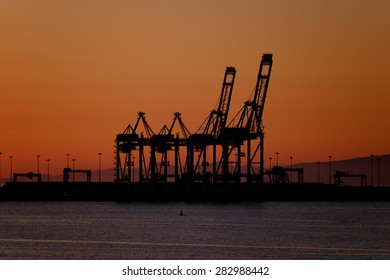 Port cranes in the sunset