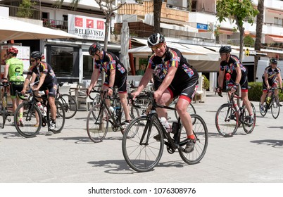 Port d Alcudia, Majorca, Balearic Islands, Spain. 2018. Dutch road riders riding on the promenade