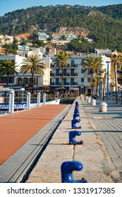 Port d'Andratx, Mallorca. 20th February 2019. View from the quayside, with moorings leading to shops and restaurants that line the bay at Port d'Andratx, Mallorca, Spain.