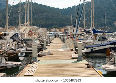 Port d'Andratx, Mallorca, Spain. 20th February 2019. The boardwalk leading to the luxury yachts moored at the Club De Vela Marina in the bay at Port d'Andratx, Mallorca, Spain.